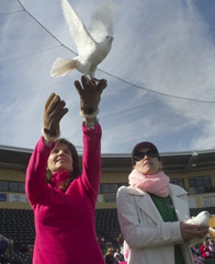 Release white doves for memorial service